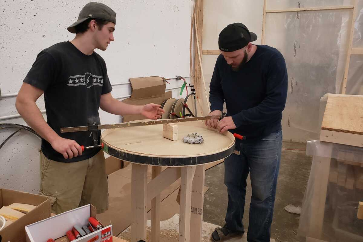 Nolan and Jeremy Working on a Board