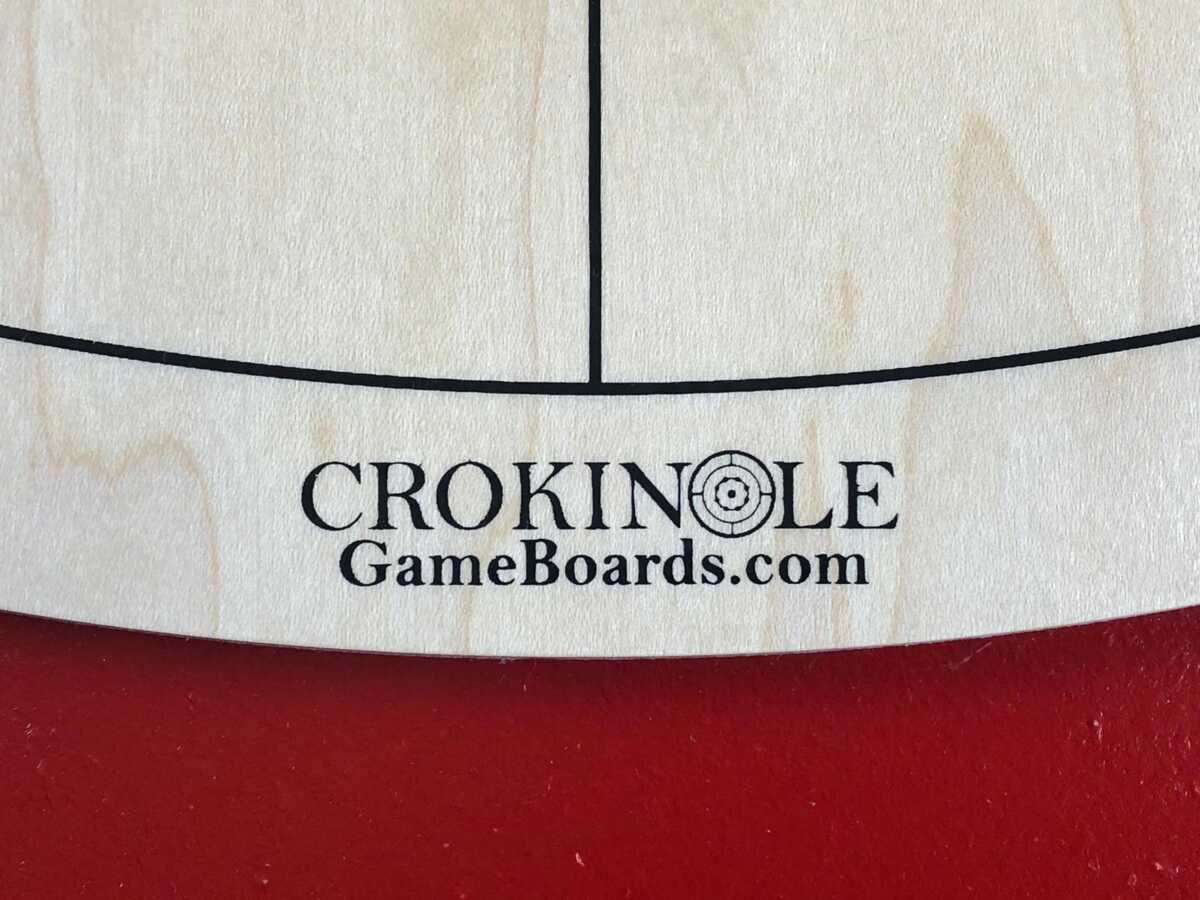 Tracey Tour Crokinole Board (Red Edition) Logo by Crokinole Game Boards