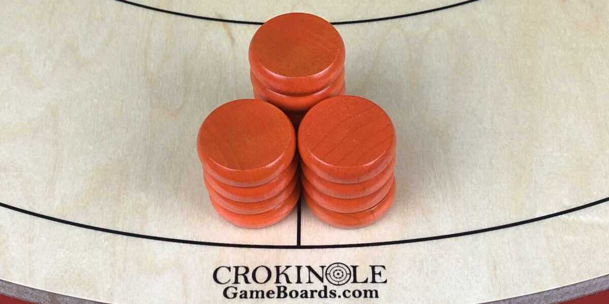 Orange Crokinole Buttons (Close) Logo - Crokinole Game Boards